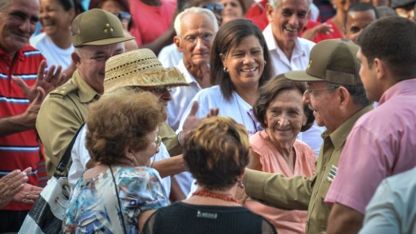Cuban President Raul Castro talks with people at the end of a meeting at the Artemisa Mausoleum monument on July 26, 2014.