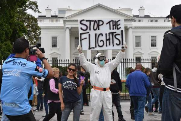 Demonstrators demand a travel ban outside the White House on Oct. 16 to stop the spread of the Ebola virus.