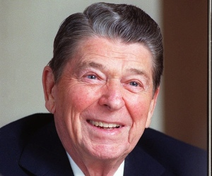 "Former President Ronald Reagan, is shown in his office in the Century City section of Los Angeles, Ca., Feb. 5, 1990.  Reagan, the cheerful crusader who devoted his presidency to winning the Cold War, trying to scale back government and making people believe it was ""morning again in America,"" died June 5, 2004.  He was 93.  (AP Photo/Bob Galbraith)"