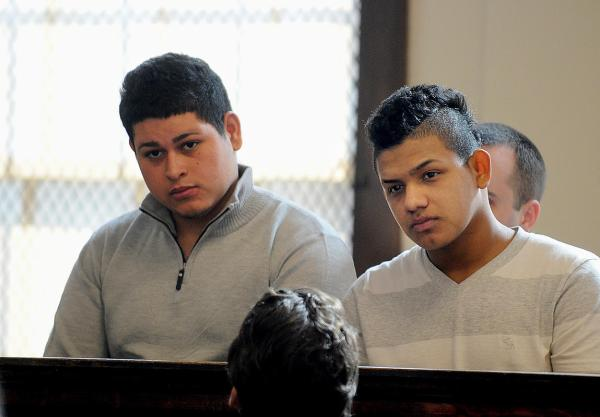 (Malden, MA, 02/01/16)  17-year-old Jose Vasquez Ardon, (LEFT) of Everett, and 17-year-old Cristian Nunez-Flores (RIGHT), also of Everett, are arraigned at Malden District Court.  Both men are facing one count each of murder and were held without bail. 19-year-old Omar Wilfredo Reyes, of Everett, suffering from a single gunshot wound to the head was taken to the hospital where he died from his injuries Jan. 4. Monday, February 01, 2016. Staff photo by Ted Fitzgerald
